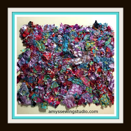 Batik Fabric Scraps cut up into small pieces, sandwiched between wash away stabilizer. Stitch thru stabilizer in any design catching fabric with stitching. Rinse stabilizer and enjoy your custom piece of Batik Fabric!