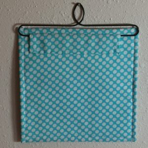 The back side view of a mini quilt from the best book for easy miniature quilt block patterns!