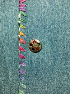 Embellish WIth Sewing Buttons. Add extra visual appeal to your clothing pieces with decorative buttons.