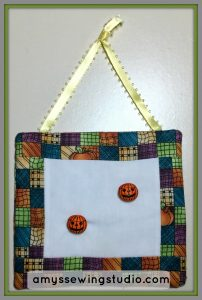 Embellish With Sewing Buttons. Ideas for using buttons with mini quilt wall hangings.